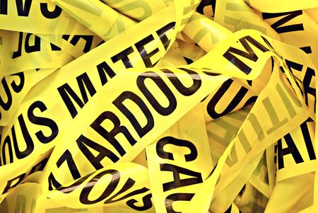 Pile of yellow plastic tape marked Cautious Hazardous Material