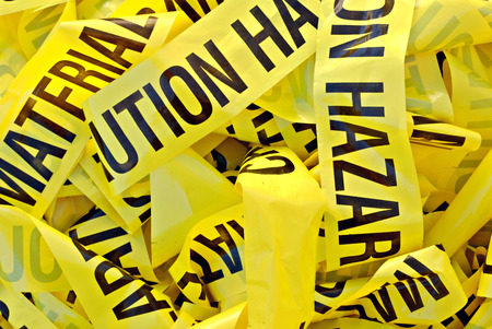 material: Pile of yellow plastic tape marked Cautious Hazardous Material