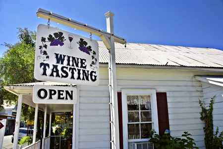 signage outdoor: Wine tasting shop and sign in a small town, Amador County, California Stock Photo