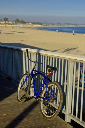 cruiser bike: Beach Cruiser style bike parked along a railing at the beach near the Boardwalk at Santa Cruz, California