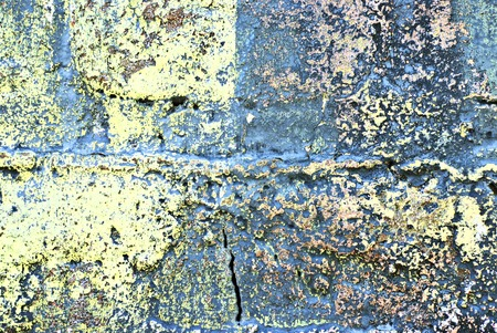 peeled: Deteriorating painted brick wall stylized with grunge effects (part of a photo illustration series)