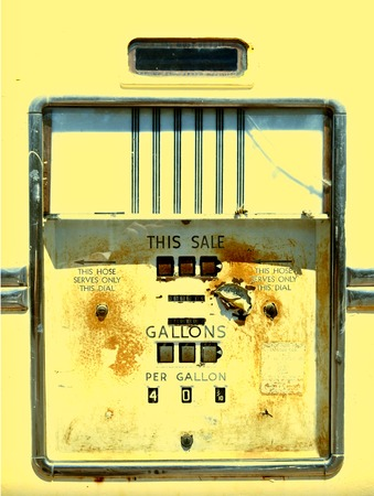 gallons: Closeup of a rusty old gas pump from the 1940s