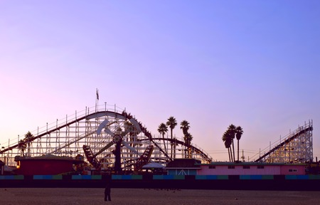 Big Dipper roller coaster at sunset at the Santa Cruz Boardwalk in California