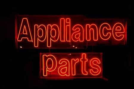 black appliances: Illuminated red appliance parts neon sign