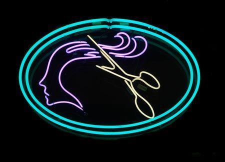Illuminated scissors cutting long hair neon sign photo