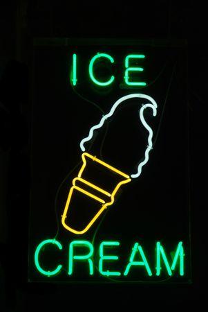 Illuminated ice cream cone neon sign on black Stock Photo - 2090281