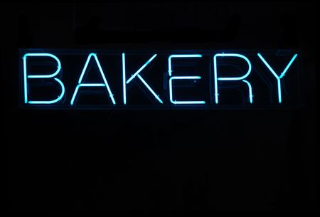 Illuminated blue bakery neon sign on a black background Stock Photo - 2090280