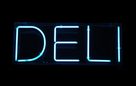 shop sign: Illuminated blue deli neon sign on a black background