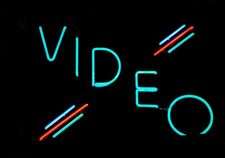 Illuminated video neon sign on black background Stock Photo - 2090278