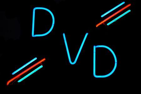 Illuminated DVD neon sign on black background Stock Photo - 2090276