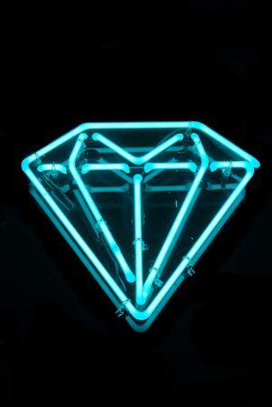 diamond shape: Illuminated blue diamond shaped neon sign Stock Photo