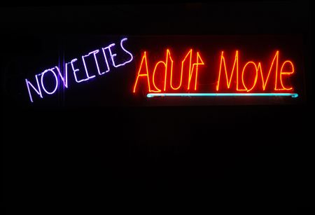 porn: Illuminated novelties and adult movie neon sign