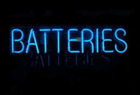 illuminated: Illuminated blue batteries neon sign on black