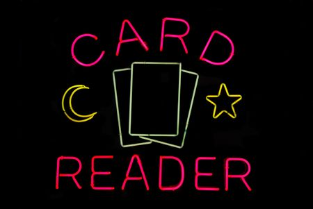 psychic: Illuminated tarot card reader neon sign on black