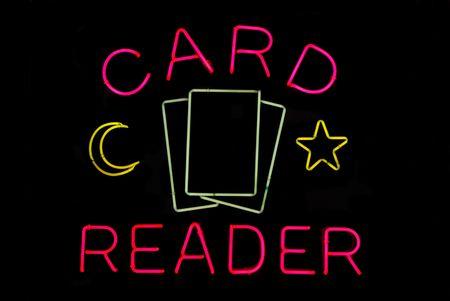 Illuminated tarot card reader neon sign on black