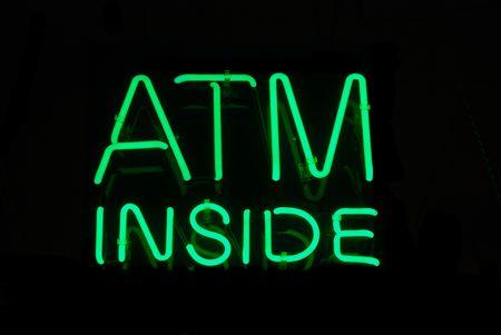 Illuminated ATM Inside neon sign on black Stock Photo - 2142548