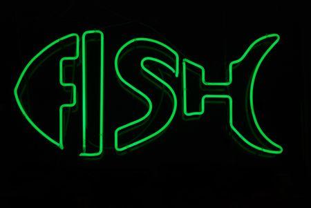 neon fish: Illuminated neon sign in shape of fish