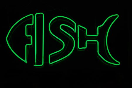 fish store: Luminosos de ne�n signo en forma de pescado