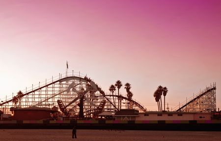 Big Dipper roller coaster at sunset at the Santa Cruz Boardwalk in California photo