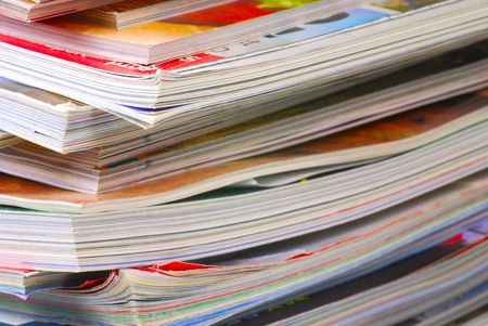 Large stack of a variety of magazines