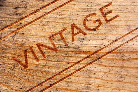 Vintage burned onto a moldy wooden wine box photo