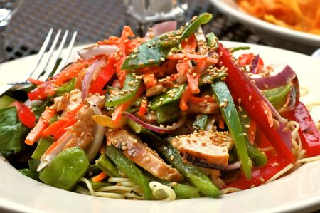 Plate of Chinese chicken salad served at an outdoor restaurant photo