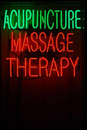 Neon sign advertising acupuncture and massage therapy