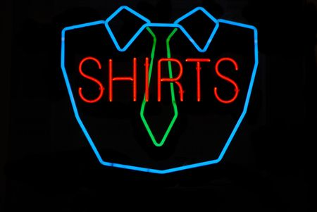dry cleaning: Neon sign at a dry cleaning business advertising shirts Stock Photo