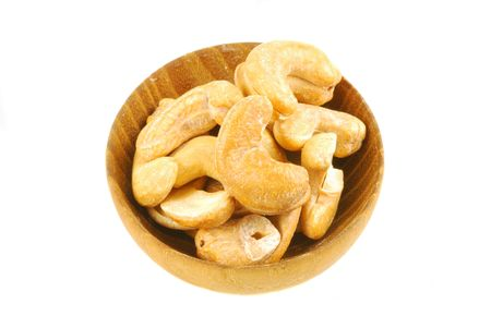 Macro of a small wooden bowl of cashews photo