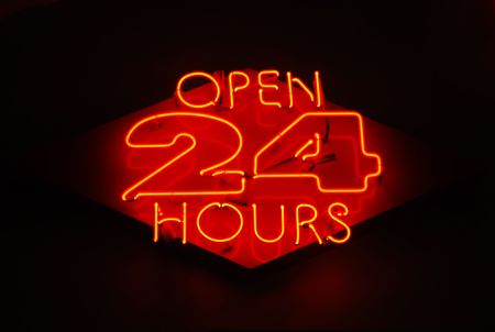 convenient store: Open 24 Hours neon sign on a restaurant Stock Photo