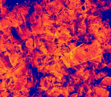 Macro of a broken green glass bottle on asphalt in infrared - photo illustration