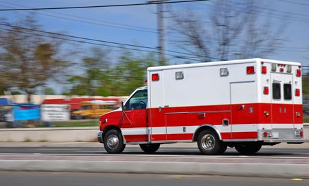 Ambulance speeding on an American street heading to an emergency Stock Photo