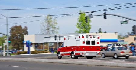 Ambulance speeding past traffic on an American street heading to an emergency Stock Photo - 3140915