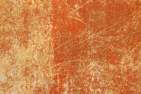 Rusty orange painted wall with distressed patterns Stock fotó