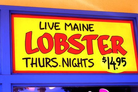 thursday: Live Main Lobster Thursday Nights $14.95 sign hand-painted on a restaurant wall