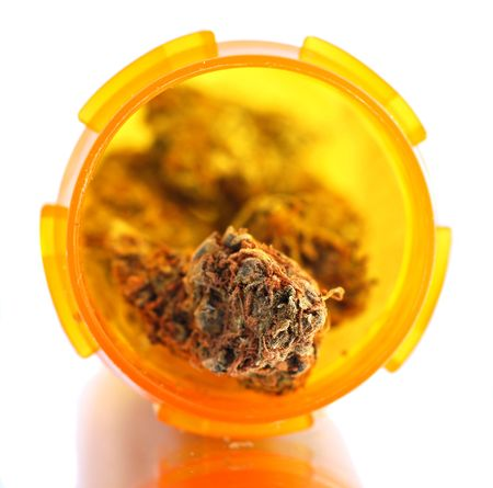 bud weed: Dried medical cannabis buds in a prescription bottle