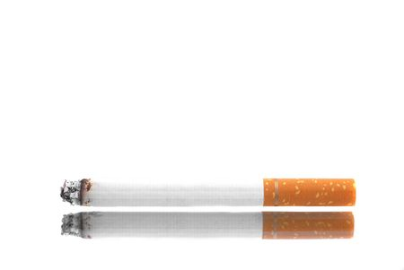 Lit cigarette isolated on a white background 写真素材