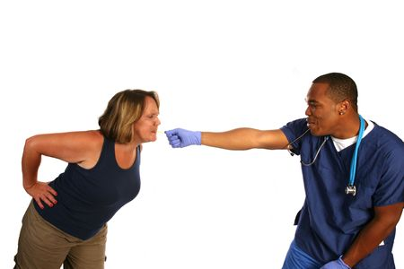Patient and doctor playing tug of war with a tongue depressor Stock Photo - 3506581