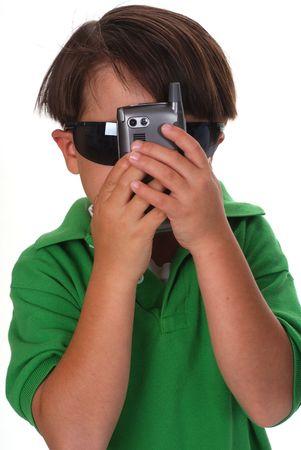 kindergartner: Boy hiding behind a cell phone