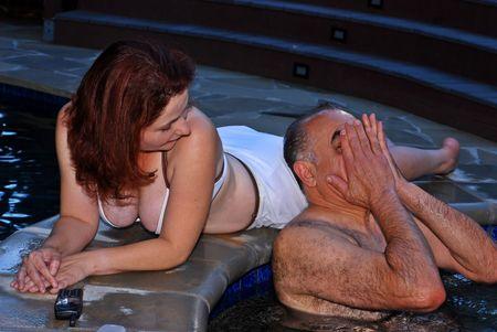 soak: Couple enjoying an evening soak together in a hot tub