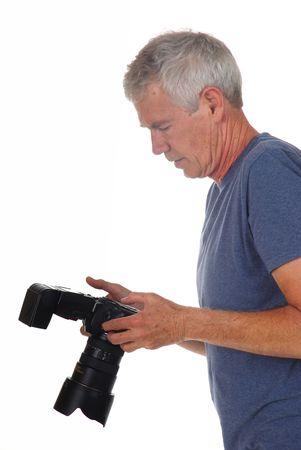 hobbyist: Senior male photographer taking pictures on a white background Stock Photo