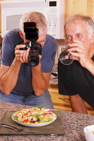 Senior male photographer taking food photos with friends Stock fotó - 3506751