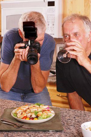 hobbyist: Senior male photographer taking food photos with friends