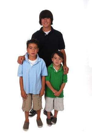 Portrait of three Asian-Caucasian brothers on white background photo