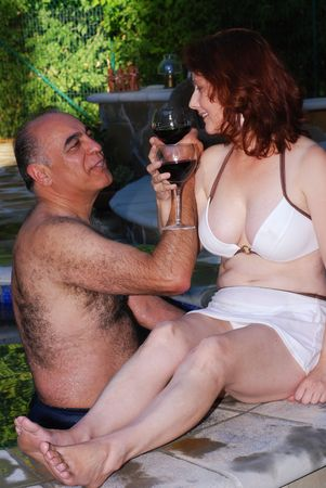 hot tub: Middle aged couple enjoy relaxing at a spa resort