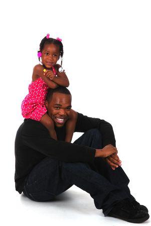 Little girl sitting on top of her uncle's shoulders Standard-Bild