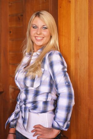 Young adult blonde woman inside a stable on a country farm Stock Photo - 3654765