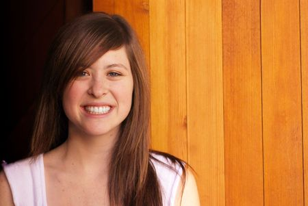 Young adult brunette woman inside a stable on a country farm Stock Photo - 3654764