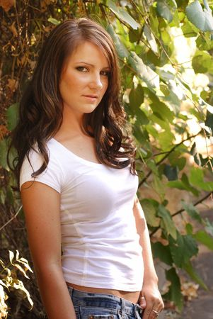 Young adult brunette woman in the countryside Stock Photo - 3654763