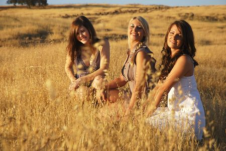 Young women in a dried grassy meadow photo